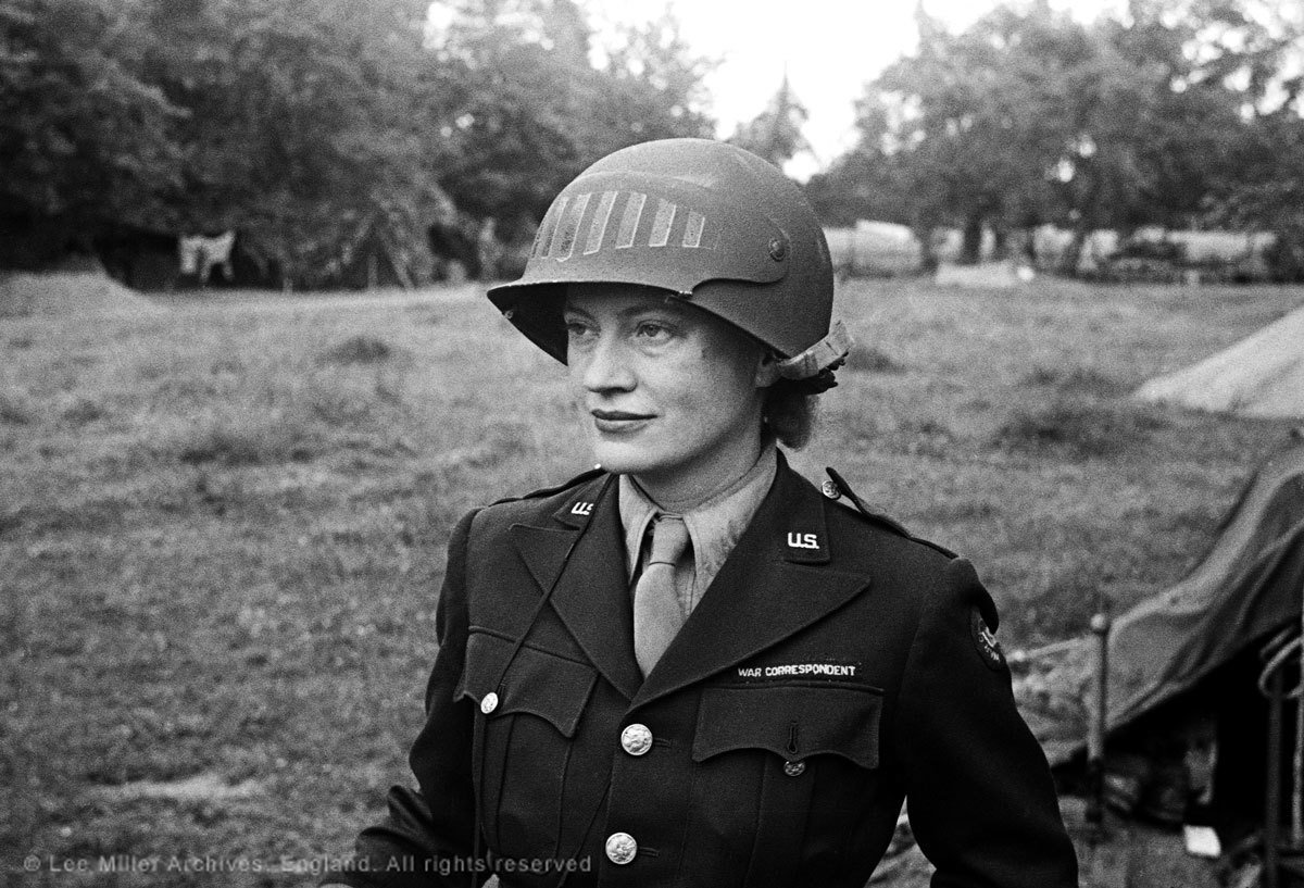 Lee Miller in a steel helmet specially designed for using a camera, Normandy, France, 1944 © The Penrose Collection, England 2015. All rights reserved.