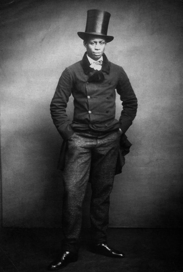 A young dandy wearing a formal suit and top hat, c.1890. Courtesy of Hulton / Getty